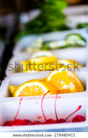 Cocktail garnishes at the bartender station. - stock photo