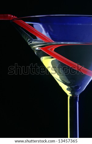 Cocktail glass close-up over black background - stock photo