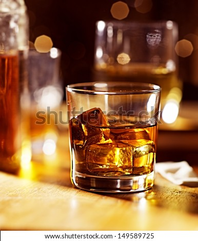 cocktail glass of whiskey on wood bar - stock photo