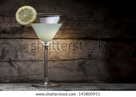 Cocktail glass over a wooden background - stock photo