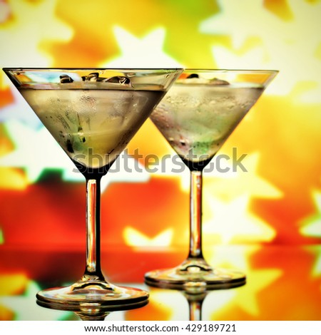 Cocktail glasses and blurred stars in the background - stock photo
