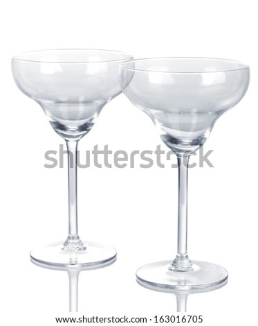 Cocktail glasses isolated on white - stock photo