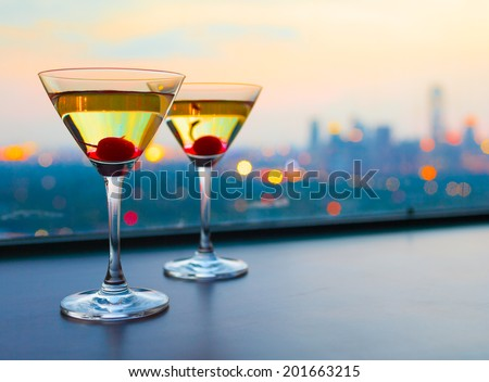 Cocktail glasses with city view. - stock photo