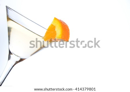 Cocktail in a martini glass garnished with an orange slice. Still life on white background. Lot of copy space - stock photo