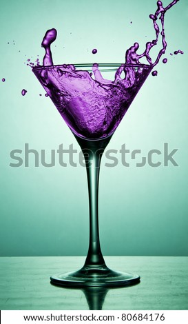 Cocktail in martini glass on the desk - stock photo