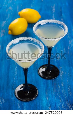 Cocktail in martini glasses on the wooden table - stock photo