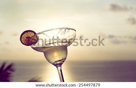 Cocktail in the sunset - stock photo