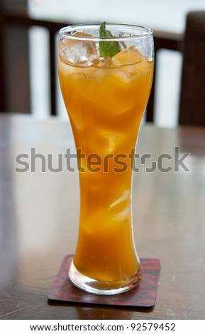cocktail, mango juice with ice cubes in a glass - stock photo