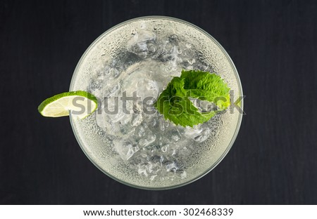 Cocktail margarita on the dark background - stock photo