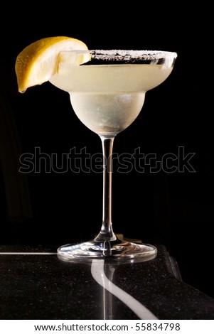 Cocktail margarita with lemon on black  background - stock photo