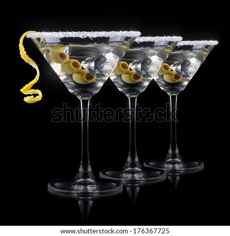 Cocktail martini on a black party background - stock photo