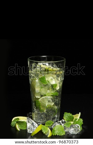 Cocktail mojito isolated on black background - stock photo
