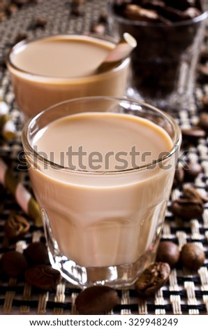 Cocktail of coffee and cream in a glass container. Selective focus