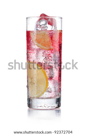 Cocktail of red beverage with some lemon slices - stock photo