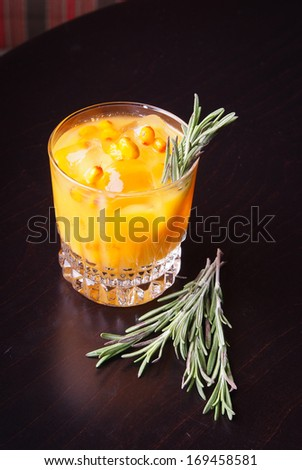 cocktail of sea buckthorn with thyme - stock photo