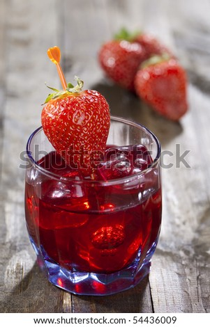 Cocktail of strawberries on wooden table top - stock photo