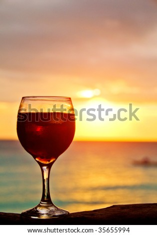 Cocktail on a Beach in Sunset Light - stock photo