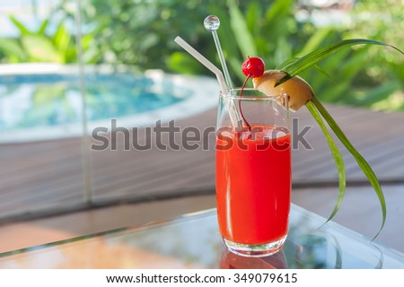 cocktail on table beside swimming pool the resort - stock photo