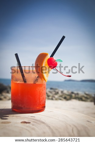 Cocktail on the beach - stock photo