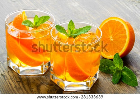 Cocktail. Orange juice with  mint and ice rustic wooden table - stock photo