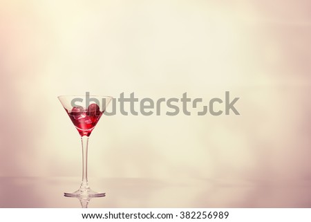 Cocktail over ice, creatively lit with plenty of copy space - stock photo