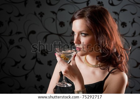 Cocktail party woman evening dress enjoy drink on black background - stock photo
