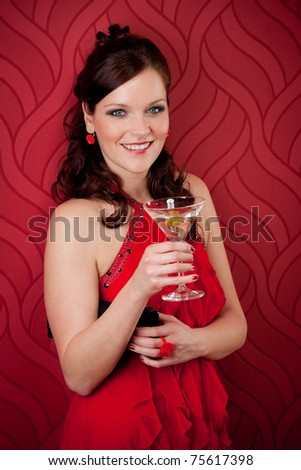 Cocktail party woman evening dress enjoy drink on red background - stock photo