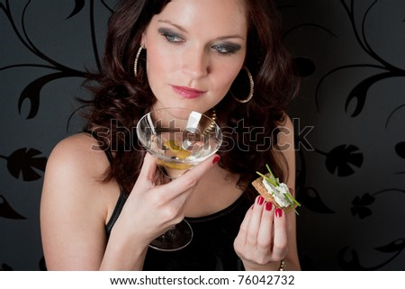 Cocktail party woman in evening dress champagne appetizer - stock photo