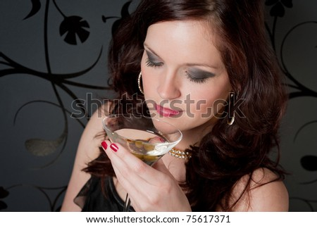 Cocktail party woman in evening dress enjoy drink - stock photo