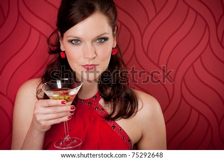 Cocktail party woman in evening dress enjoy drink on red background - stock photo