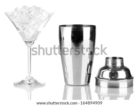 Cocktail shaker and cocktail glass isolated on white - stock photo
