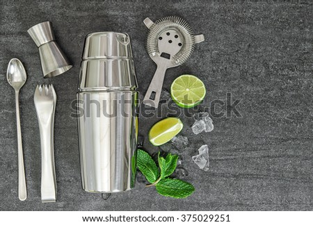 Cocktail shaker and drink ingredients. Mojito. Caipirinha - stock photo