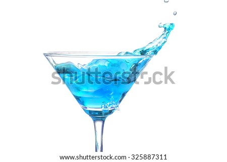 cocktail Splash in a martini glass on white background - stock photo