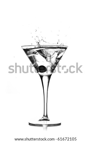 cocktail splash on elegant glass - stock photo
