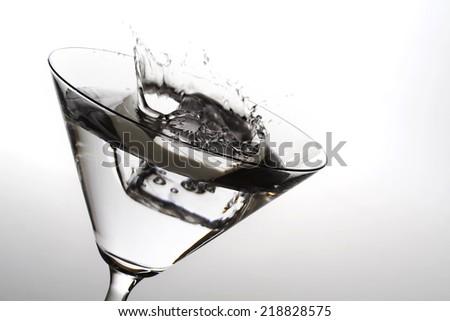 cocktail splash on white - stock photo