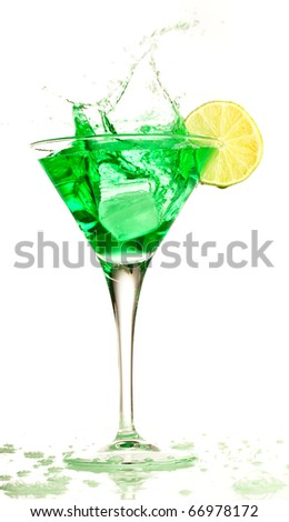 cocktail splashing into glass on a white background - stock photo