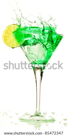 cocktail splashing into glass on a white background