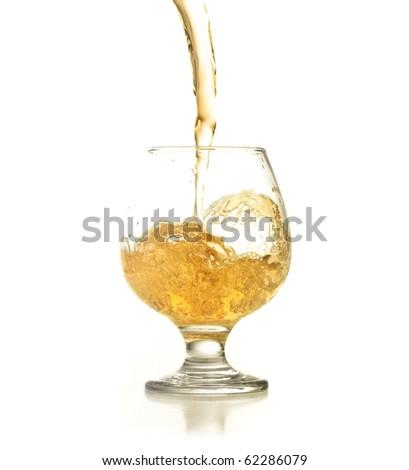 Cocktail splashing on a glass on white background - stock photo