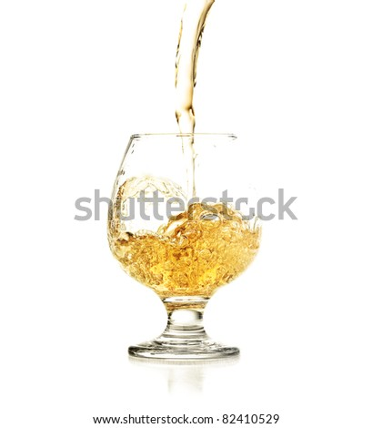Cocktail splashing on a glass on white background - stock photo