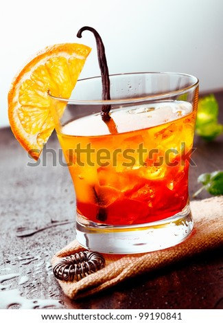 Cocktail Tequila sunrise on a wooden background with Orange Fruit, juice and some fresh leaves - stock photo