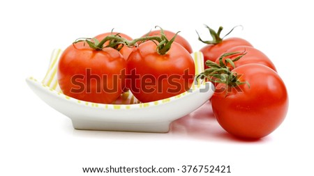 cocktail tomatoes on white background