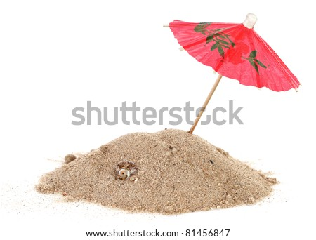 Cocktail Umbrella in Sand Mound with Shells - stock photo