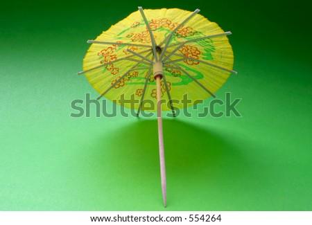 cocktail umbrella - yellow #3 - stock photo