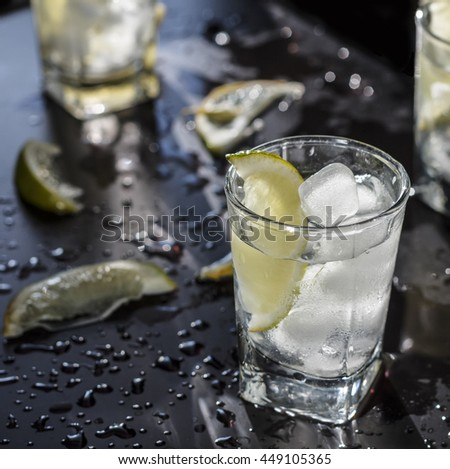 Cocktail vodka or gin with ice vintage.vodka in a glass with ice, lime, a cocktail bar, alcohol, alcoholic beverage. Closeup
