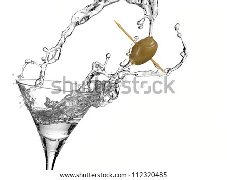 Cocktail with a olive splash - stock photo