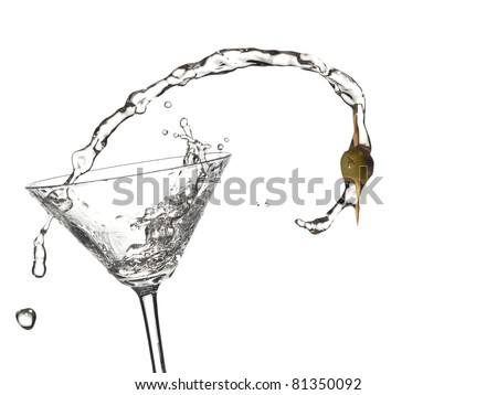 Cocktail with a olive up from a martini glass - stock photo