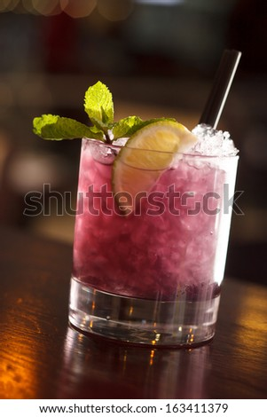 cocktail with blackberries and straw - stock photo