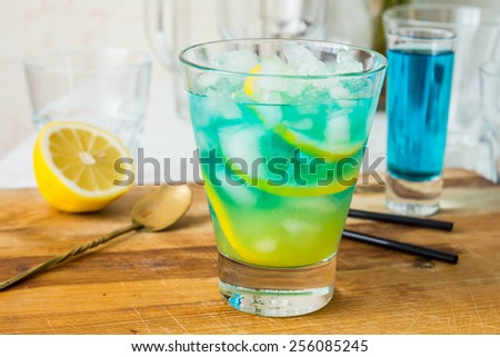 Blue curacao stock images royalty free images vectors for Orange and blue cocktails
