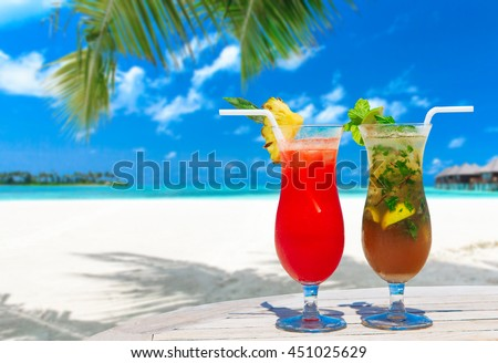 cocktail with blur beach on background - stock photo