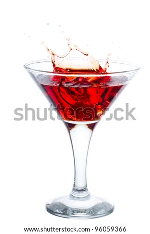 Cocktail with cherry splash isolated on white